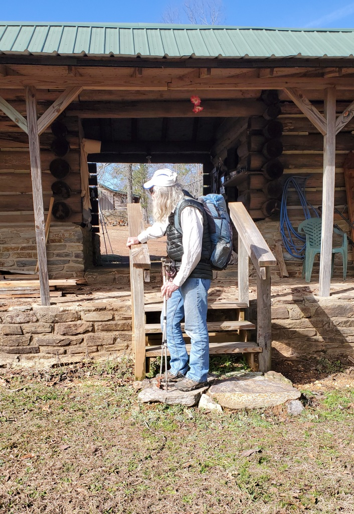 Nimblewill Nomad at the steps of his cabin on Flagg Mt